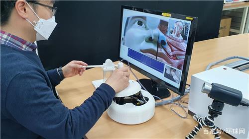韩媒:韩国研制出核酸检测采样机器人,医务人员和患者不直接接触